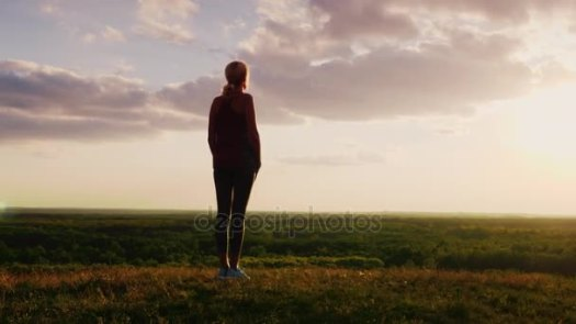 depositphotos_153219860-stock-video-silhouette-of-a-woman-standing