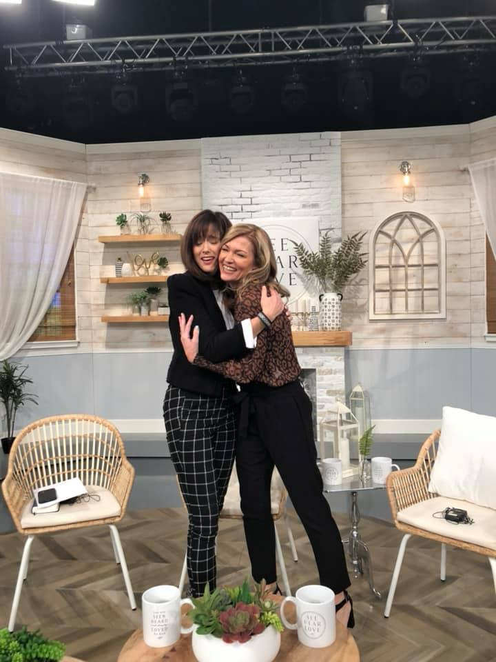 Ann Voskamp and I share a hug on set at See Hear Love.